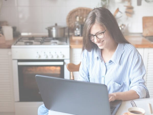 Photo of woman working from home